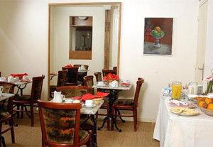 Salle petit déjeuner Hôtel Cyrnos Paris