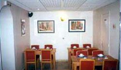 Salle petit déjeuner Au Nouvel Hôtel Lyon Paris