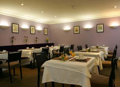 Salle petit déjeuner Hôtel le Royal Paris