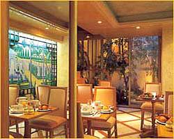 Salle petit déjeuner Hôtel Renoir Paris