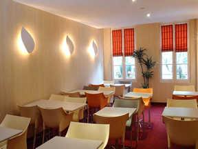 Salle petit déjeuner Relais de Paris Cambronne
