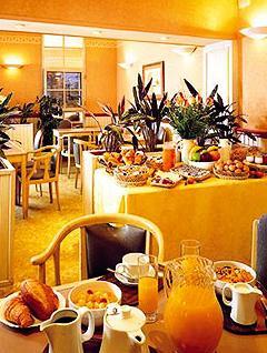 Salle petit déjeuner Hôtel Armstrong Paris